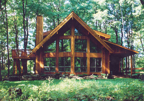 Woodland post beam custom cabins garages post beam homes for Small post and beam cabin plans