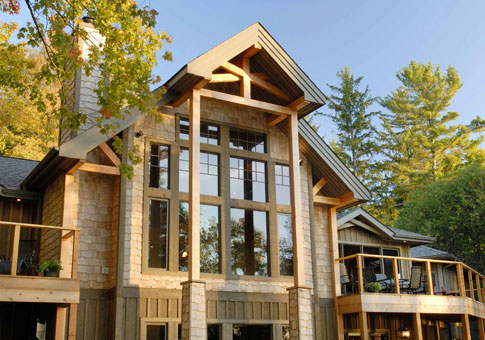 Post beam custom retreats cottages post beam homes for Contemporary post and beam house plans